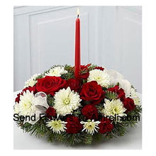 This Centerpiece spreads joy and good tidings during this seasonal time of generosity and togetherness. Rich red roses, red mini carnations, white Gerberas,  simple taper candle for a colourful and eye-catching floral display that will make your table complete this season. A wonderful way to spruce up your festivities or brighten the season for your family or friends! (Please Note That We Reserve The Right To Substitute Any Product With A Suitable Product Of Equal Value In Case Of Non-Availability Of A Certain Product)