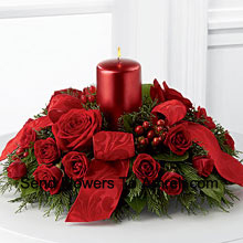 A crimson display of holiday warmth and cheer. Rich red roses and Red Carnations With A Candle  to create a heart-warming centerpiece. Bedecked with bright red ribbon, this design will bring the spirit of the holiday season to their gatherings and celebrations with style and grace.� (Please Note That We Reserve The Right To Substitute Any Product With A Suitable Product Of Equal Value In Case Of Non-Availability Of A Certain Product)